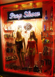 Peep show window displaying pornographic entertainment at Cherries on St. Mark's Place in New York City.