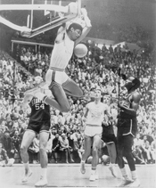 Lew Alcindor Kareem Abdul-Jabbar reaches over backwards to score