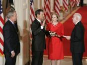 Roberts is sworn in as Chief Justice by Justice John Paul Stevens in the East Room of the White House, September 29, 2005.