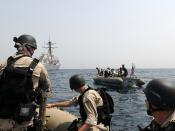 Members of the visit, board, search and seizure team from USS Truxtun ride in rigid hull inflatable boats