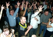 English: A crowd in Colorado Springs, Colorado, enthusiastically cheers on a live band at the downtown club Southside Johnny's.