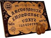 A modern ouija board plus planchette