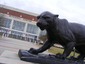 English: The Jaguar statue and the Mitchell Center Arena.