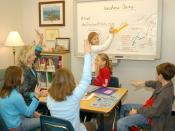 English: Virginia Beach, Va. (Jan. 17, 2007) - Guidance counselor Elizabeth Prince facilitates an Anchors Away program for children at Christopher Farms Elementary, Virginia Beach, Va. The program was created 10 years ago to help children with deployed pa