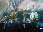 A reunited Led Zeppelin in December 2007 at The O 2 in London for the Ahmet Ertegün tribute show. From left to right: John Paul Jones, Robert Plant, and Jimmy Page. On drums is Jason Bonham, the son of the deceased John Bonham.