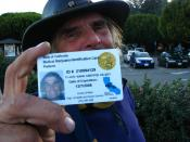 English: Man holding a California state-issued card authorizing him to obtain medical cannabis