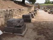 The Bases of Zanes at Olympia, Greece. Statues of Zeus were erected on these bases, paid for by fines imposed on those who were found to be cheating at the Olympic Games. The names of the athletes were inscribed on the base of each statue to serve as a wa