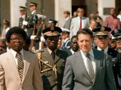English: Secretary of Defense Caspar W. Weinberger hosts Armed Forces Full Honors Arrival Ceremony for His Excellency, Commander in Chief Samuel Kanyon Doe (L, tan suite), Head of State of the Republic of LIBERIA outside the Pentagon's River entrance. Loc