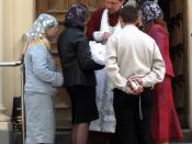 English: A Russian Orthodox priest, parents, godparents and a baptized baby