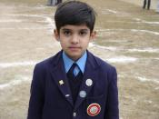 A young Pakistani student in his school uniform.