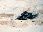 English: An Iraqi T-54A or Type 59 tank lies in ruins in the aftermath of an Allied bombing attack during Operation Desert Storm.
