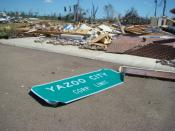 English: The town sign for Yazoo City, Mississippi, along with the ruins of a large brick building. The damage was caused by an April 24, 2010 tornado which killed 10 people in Mississippi.