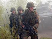 English: During exercise Joint Resolve 26, in Bosnia and Herzegovina (BiH), soldiers from the German Battle Group's 2nd Reinforced Infantry Company, armed with Heckler and Koch automatic assault rifles, seek to capture French soldiers playing the role of