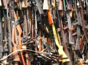 Pyre of smuggled weapons in Uhuru Gardens, Nairobi, Kenya. Original caption states,