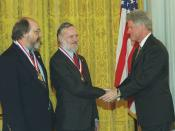 English: Ken Thompson and Dennis Ritchie being awarded the National Medal of Technology from Bill Clinton