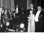 German Press Ball 1939. Dr. Ferdinand Porsche presents the Volkswagen tombola prize to Mrs. Elsa Ellinghausen, the lucky winner.