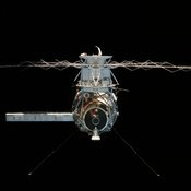 English: Skylab 4, Skylab Multiple Docking Adapter (MDA), Apollo Telescope Mount (ATM) and solar array as the Apollo Command Module undocks and moves away.