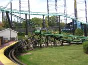 A scene from Kennywood, an amusement park located in West Mifflin, Pennsylvania on the Monongahela River. This is a view from the station of the Phantom's Revenge looking toward the Turtle (Kennywood). Part of the track of the Thunderbolt is visible as we