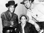 Publicity photo from the television program The Rifleman. Pictured from left: Sammy Davis, Jr., Johnny Crawford, and Chuck Connors.