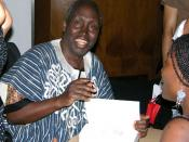Ngũgĩ wa Thiong'o signs copies of his new book Wizard of the Crow at the Congress Centre in central London. Wizard was his first book in 20 years, following 22 years of exile due to his highly political work (including the bestselling novel Petals of Bloo