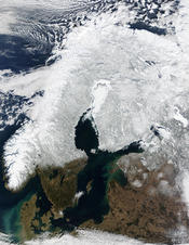 English: Snow Cover Across Scandinavia. In this mostly cloud-free true-color scene, much of Scandinavia can be seen to be still covered by snow. From left to right across the top of this image are the countries of Norway, Sweden, Finland, and northwestern