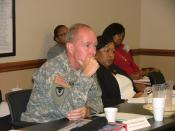 English: Col. Dennis M. Thompson, AMC Chief of staff, and Jean James, AMC director of EEO, listen to briefings at the annual AMC EO and EEO roundtable in Huntsville, Ala. Sept. 15-17. U.S. Army photo.