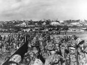 U.S. Marine reinforcements wade ashore to support the beachhead on Okinawa, 31 March 1945.