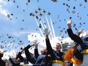 English: Cadets of the Air Force Academy Class of 2003 celebrate at graduation ceremonies on May 28, 2003 as the Air Force Thunderbirds fly overhead. The 974 students marked the academy's 45th graduating class.