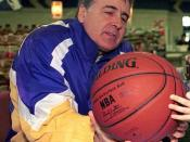 Cropped version of Ryan Caron (not shown), a five-year old dependant at Royal Air Force (RAF), Lakenheath, UK gets National Basketball Association (NBA) Hall-of-Famer Gail Goodrich to autograph his basketball. Mr. Goodrich is part of the 3RD Annual Hardco