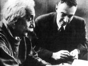 Albert Einstein (left) with J. Robert Oppenheimer (right) working on the Manhattan Project