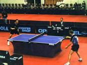 A competitive table tennis game.