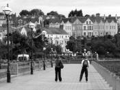 English: Rollerblading by Bangor marina Two 'rollerbladers' make their way along the path by Bangor marina (unseen, to right). Houses at Mount Royal, Mount Pleasant and the Princetown Road are beyond.