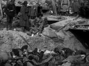 Russian soldiers looking down at a trench filled with corpses of Japanese soldiers, Port Arthur