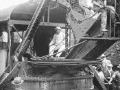 President Theodore Roosevelt sitting on a steam shovel at the Panama Canal.