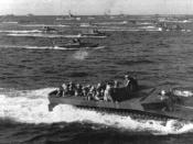LVT-4s like these ferried French troops during Operation Camargue. Here, LVT-4s are pictured carrying American Marines to the beaches of Iwo Jima.