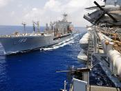 USNS Joshua Humphreys refuels USS Boxer during replenishment.