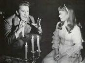 A screenshot of Kirk Douglas and Jane Wyman in The Glass Menagerie
