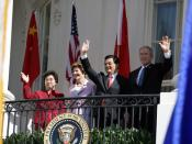 President George W. Bush, Chinese President Hu Jintao, Laura Bush and Hu's wife, Liu Yongqing, wave from the South Portico balcony after the South Lawn Arrival Ceremony at the White House,