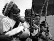 A capoeira bateria led by Mestre Cobra Mansa featuring three berimbaus and a pandeiro