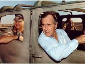 (George H.W. Bush riding in a Humvee with General Schwarzkopf in Saudi Arabia, November 22, 1990)