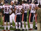 A Photo of the Bears' 2007 Captains, taken on October 7, 2007 at Lambeau Field. In this Photo (left to right): Muhsin Muhammad - 87 - Wide receiver Brendon Ayanbadejo 94 - Gunner Adewale Ogunleye - 93 - Defensive end Brian Urlacher - 54 - Middle linebacke
