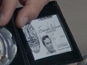 Columbo's warrant card and badge with the name Frank Columbo in the episode