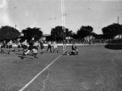 English: Rugby Union match between Queensland and New South Wales, April 1938 The referee is blowing his whistle as a try is scored.