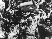 U.S. and Filipino forces surrender to the Japanese Army at Bataan