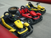 English: Go-karts on a kart racing track near the Kid's Midway at the Calgary Stampede, Calgary, Alberta, Canada.