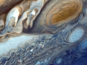 English: Detail of Jupiter's atmosphere, as imaged by Voyager 1. Suggested for English Wikipedia:alternative text for images: view of Jupiter's clouds with the Great Red Spot at top right as brown oval to right of wavy white and brown clouds. Below the Gr