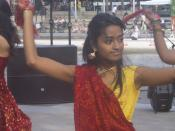 This picture was taken at the ImaginASIAN Night Market, which took place at Calgary's Olympic Plaza on Saturday, June 2, 2007. The girl was part of a group performing a folk dance from Gujarat, India.