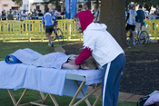 Massage therapist working at a Triathlon in Fremantle, Western Australia, Australia.