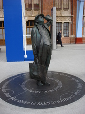 Statue (2007) of Sir John Betjeman at St Pancras Station.