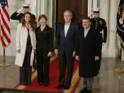 US President George W. Bush and Mrs. Laura Bush welcome Jordan's King Abdullah II and Queen Rania upon their arrival to the White House for a social dinner Tuesday evening, March 6, 2007.